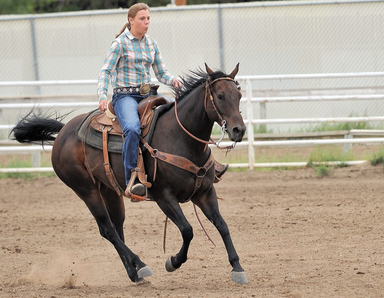 Taylor Elliott competes Monday morning inside the rodeo arena at the Routt County Fairgrounds during the ranch horse versatility competition. The event is one of several horse competitions at this year's Routt County Fair, which will shift into high gear later this week.