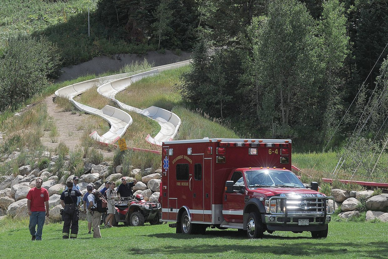 An ambulance prepares to leave the bottom of the Howler Alpine Slide on Tuesday at Howelsen Hill, where a man possibly had a heart attack while riding the slide.