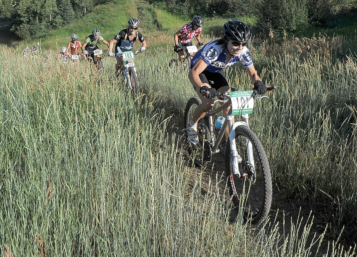 Tammy Jacques, front, and Kelly Boniface race during a 2011 Town Challenge Mountain Bike Race Series event at Emerald Mountain. Wednesday's Soul of Emerald cross-country race will wrap up this year's series.