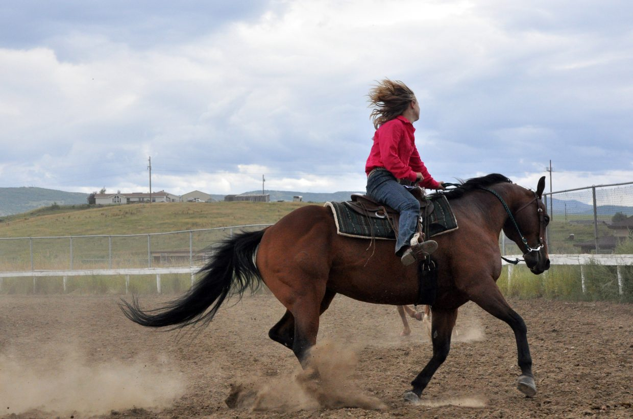 Kaitlynn Hayes practices before an open horse show Sunday at the Routt County Fairgrounds in Hayden.