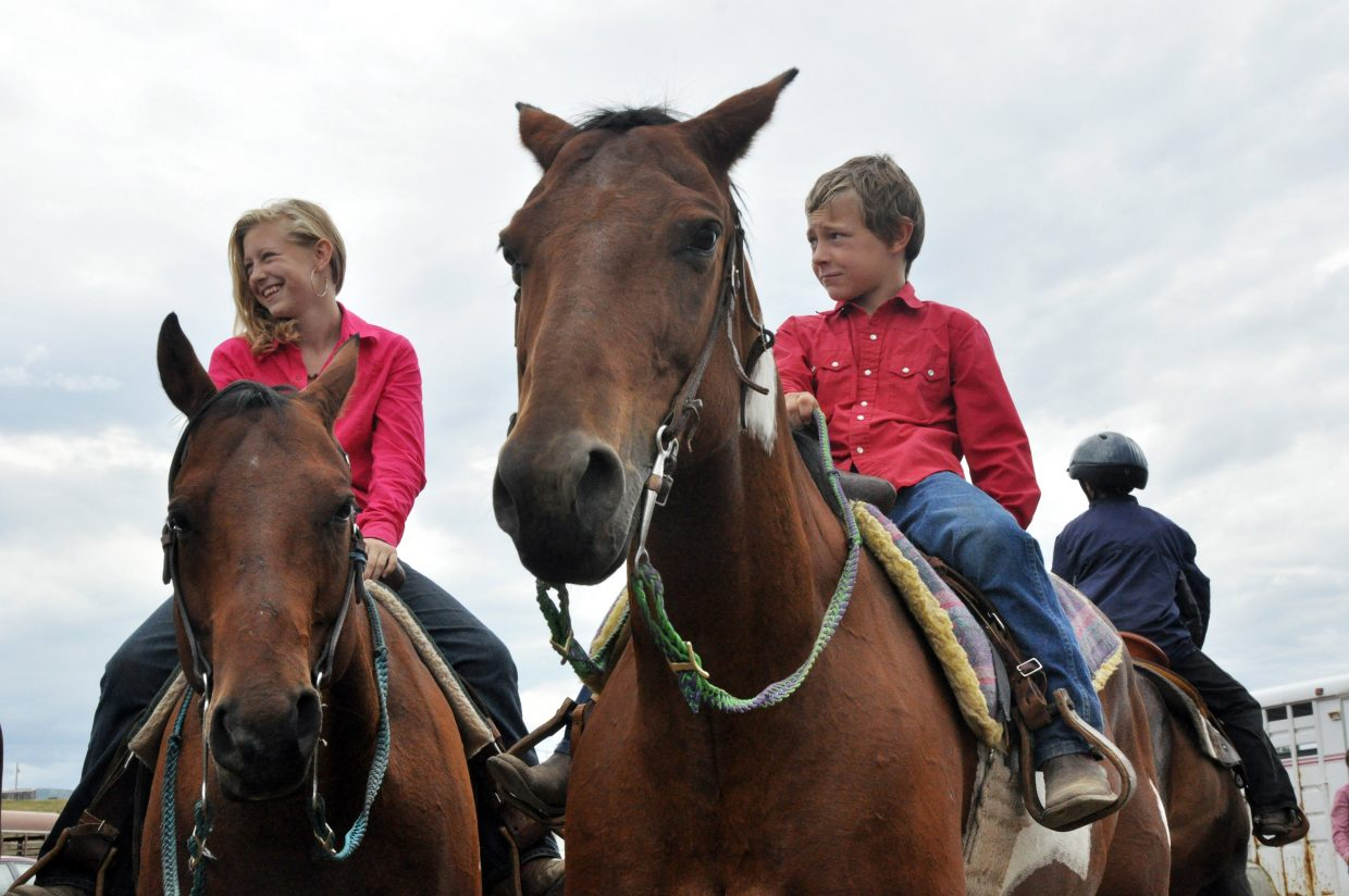 Kaitlynn and Keenan Hayes wait their turn to compete in the next round of an open horse show Sunday at the Routt County Fairgrounds. The Routt County Fair officially kicks off Thursday.