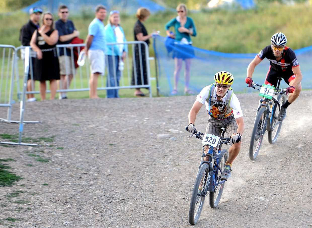Chris Speer leads the way as he and Jeff Minotto fly toward the finish line Wednesday at the Soul of Emerald cross-country Town Challenge race in Steamboat Springs.