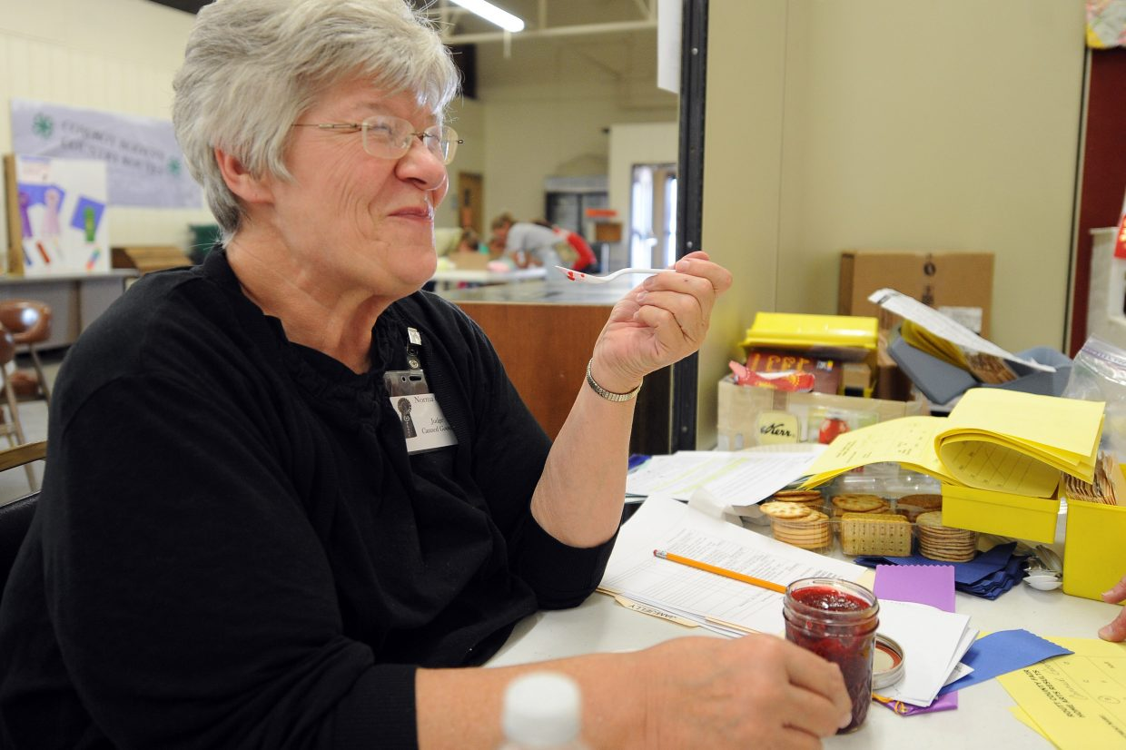 Norma Carver has been judging jellies, jams and other preserved and canned food at the Routt County Fair for 35 years. It's enough that she said she can grow quite full of the product, but she never stops appreciating it, as she did, smiling wide while tasting a raspberry winner Thursday.