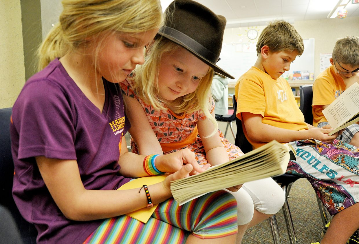 Third-graders Ellery Hodges, left, and Margaret Redfern read a book together in May in Shannon Forbes' class at Soda Creek Elementary School. Students in Steamboat Springs posted strong scores on the 2013 TCAP.