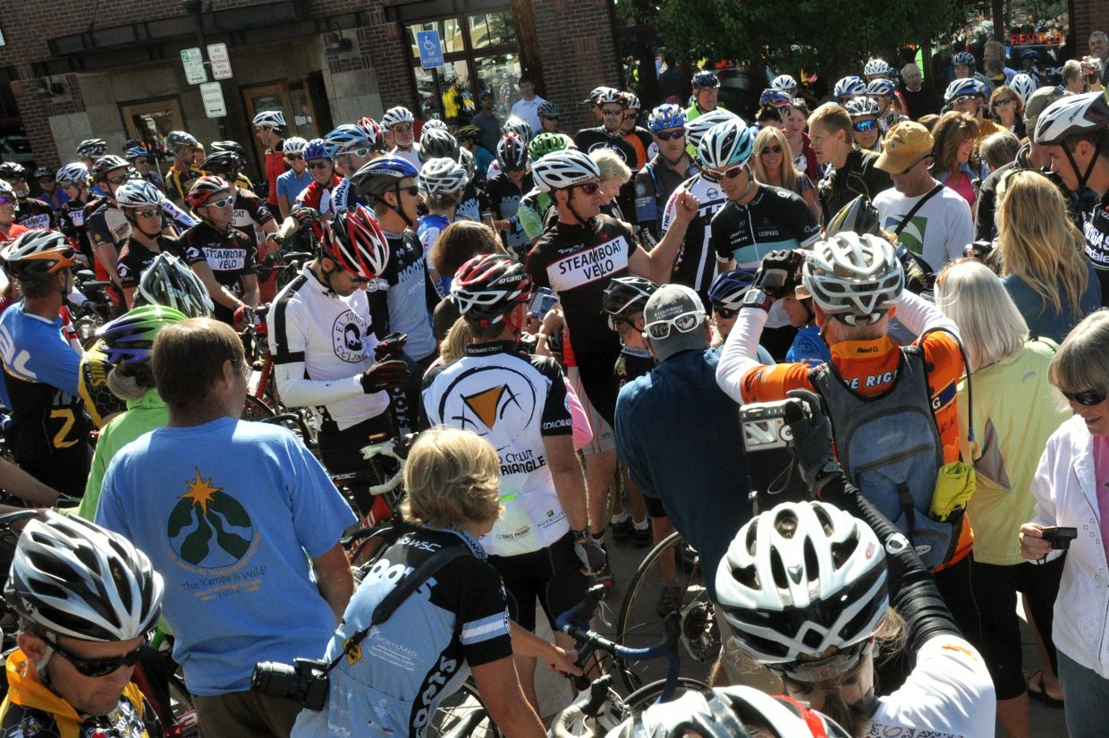 Steamboat Springs residents swarm Tour de France second place finisher Andy Schleck on Monday in front of Steamboat Ski & Bike Kare. More than 100 cyclists joined Schleck on a community bike ride.
