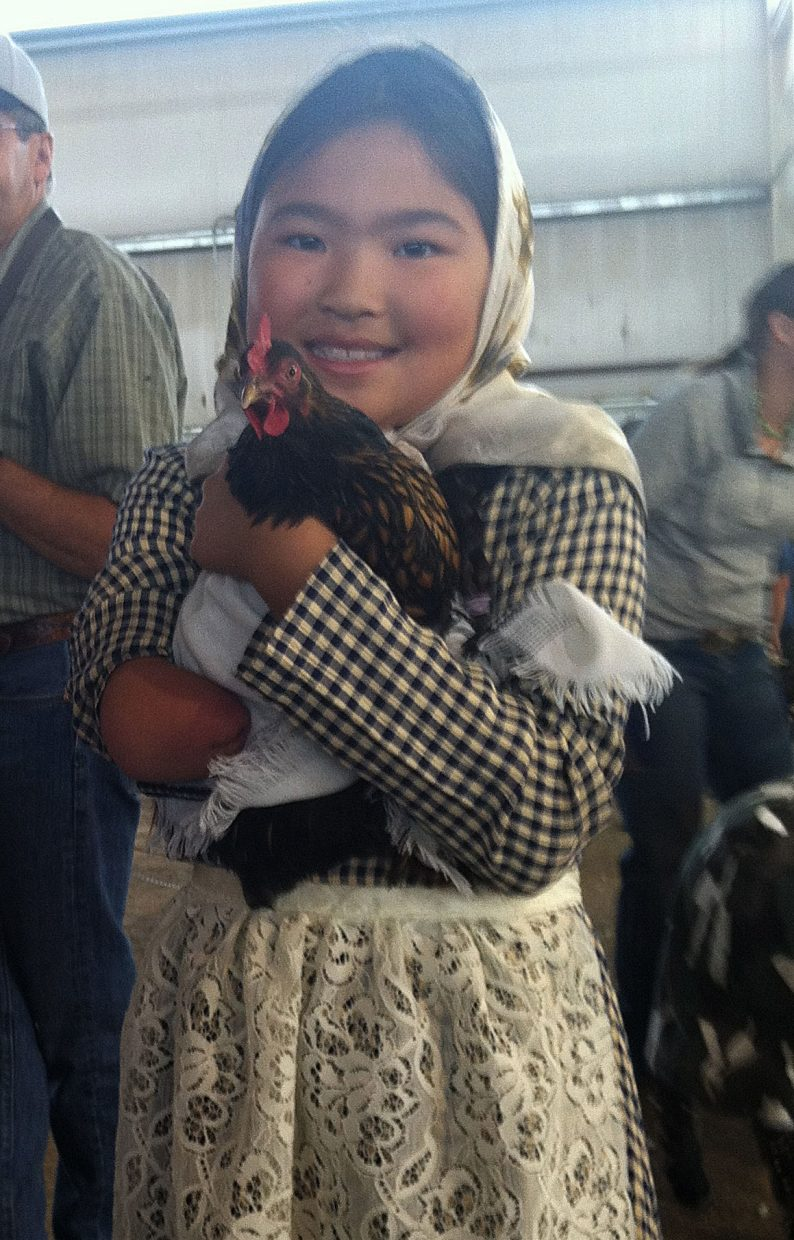 Lauren Hilley, 9, holds her Bantam hen Mocha. Lauren's theme for Friday's Dress Your Animal Contest at the Routt County Fair was pioneer-era.