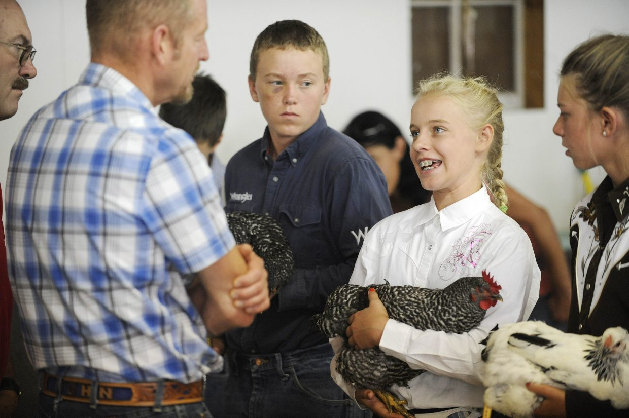 Sammy Koepfer, 13, talks to rabbit and poultry judge John Baker about her chicken Thursday during the intermediate showmanship competition at the Routt County Fair. Sammy was declared the reserve grand champion and Hallie Myhre, 13, won grand champion.