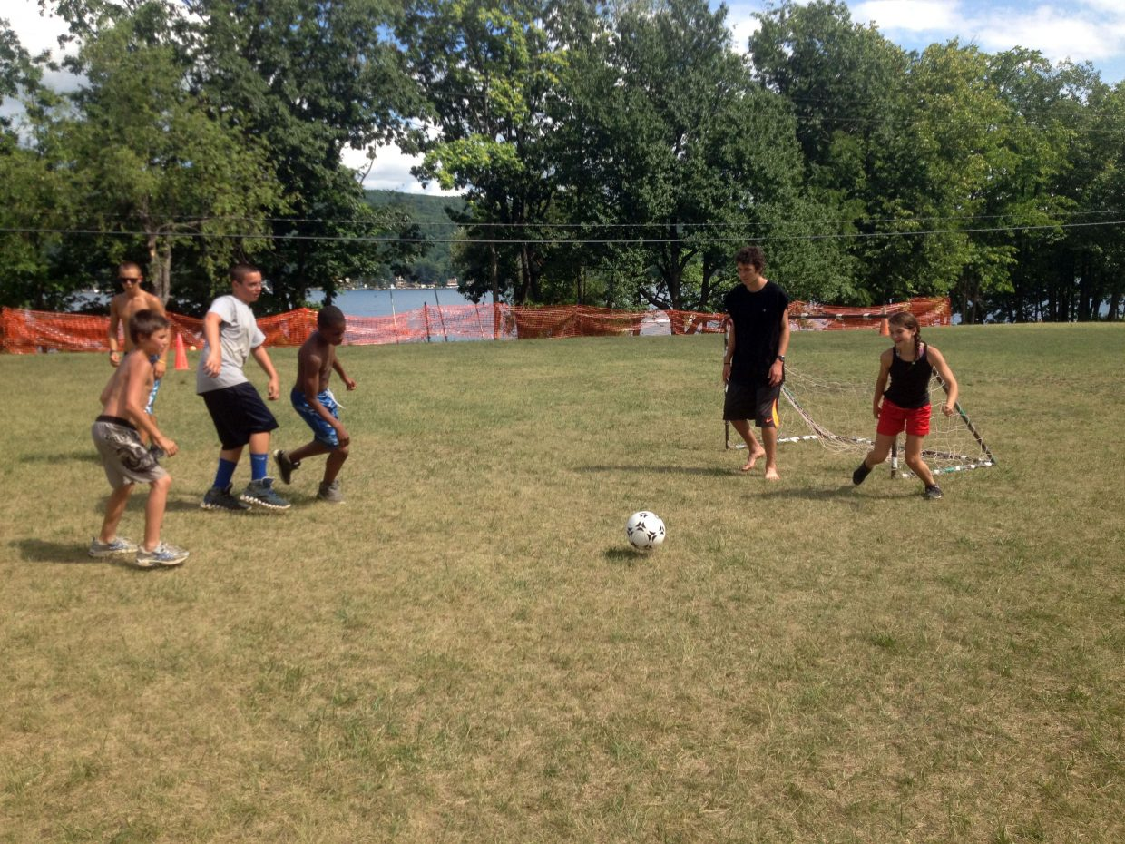 Steamboat Springs skier Pelle Seiler plays soccer with children at an upstate New York camp meant for at-risk youth.
