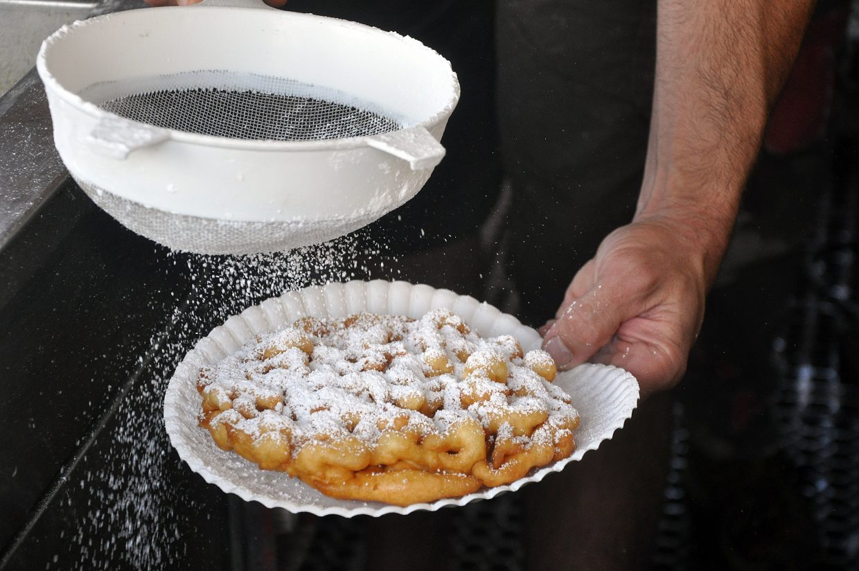 Funnel cakes are topped off with powdered sugar at the Routt County Fair in Hayden.