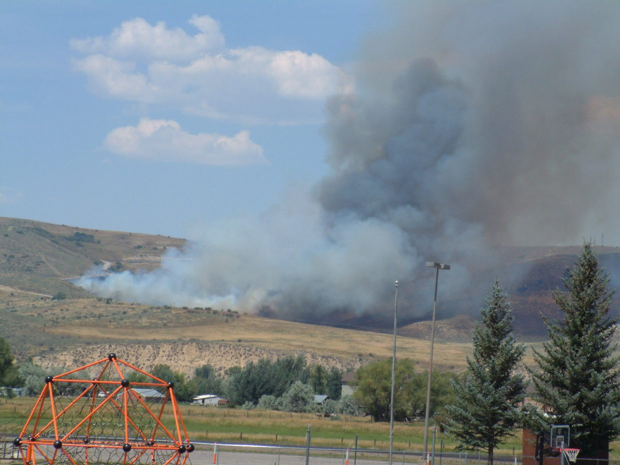 A fire along the Cog Road in Hayden has burned an estimated 500 to 1,000 acres.