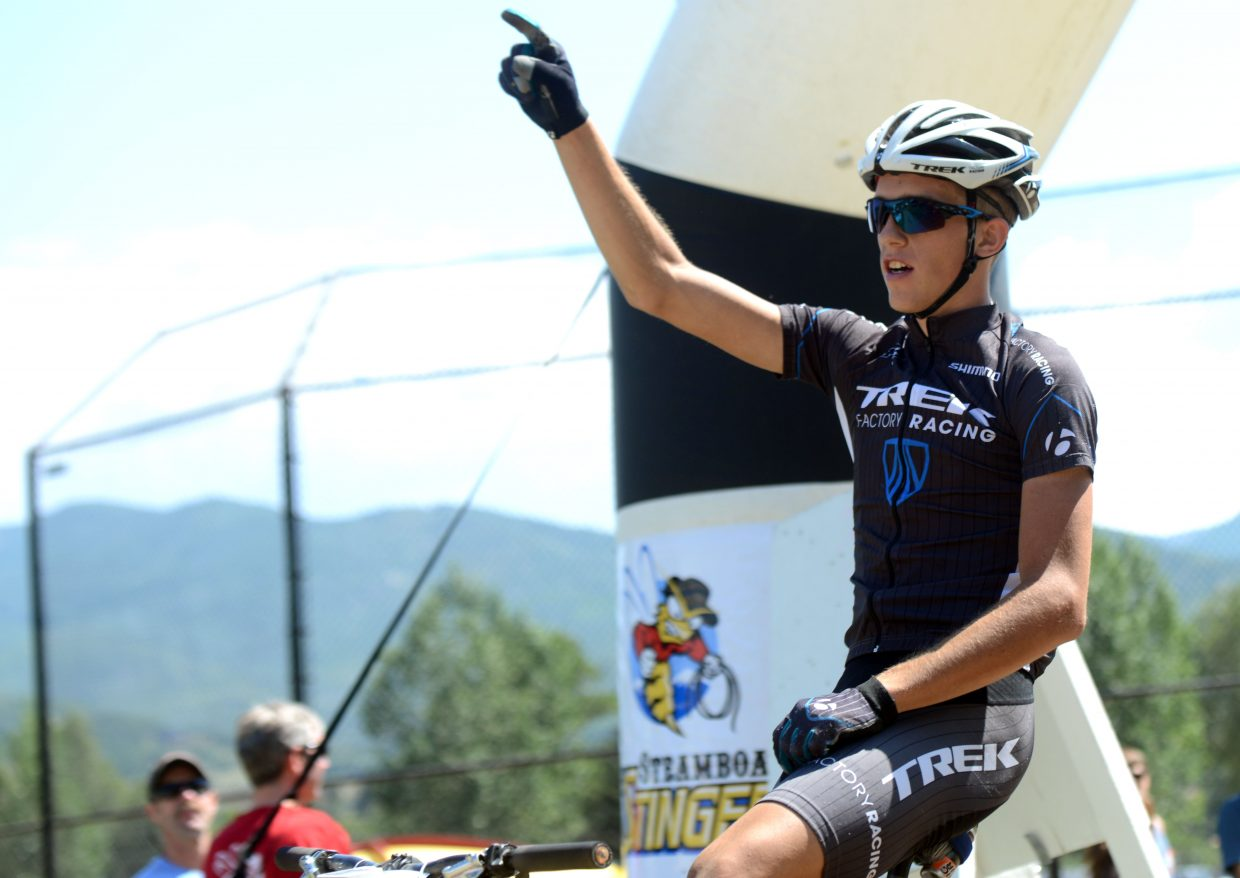 Russell Finsterwald throws up a hand as he crosses the finish line of the Steamboat Stinger 50-mile mountain bike race Saturday, winning the third-year event for the second consecutive time.