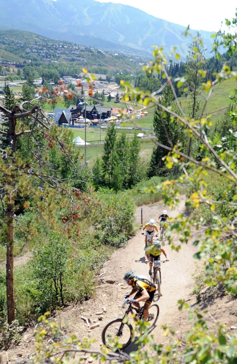 Riders pedal up Emerald Mountain on Saturday during the Steamboat Stinger race.