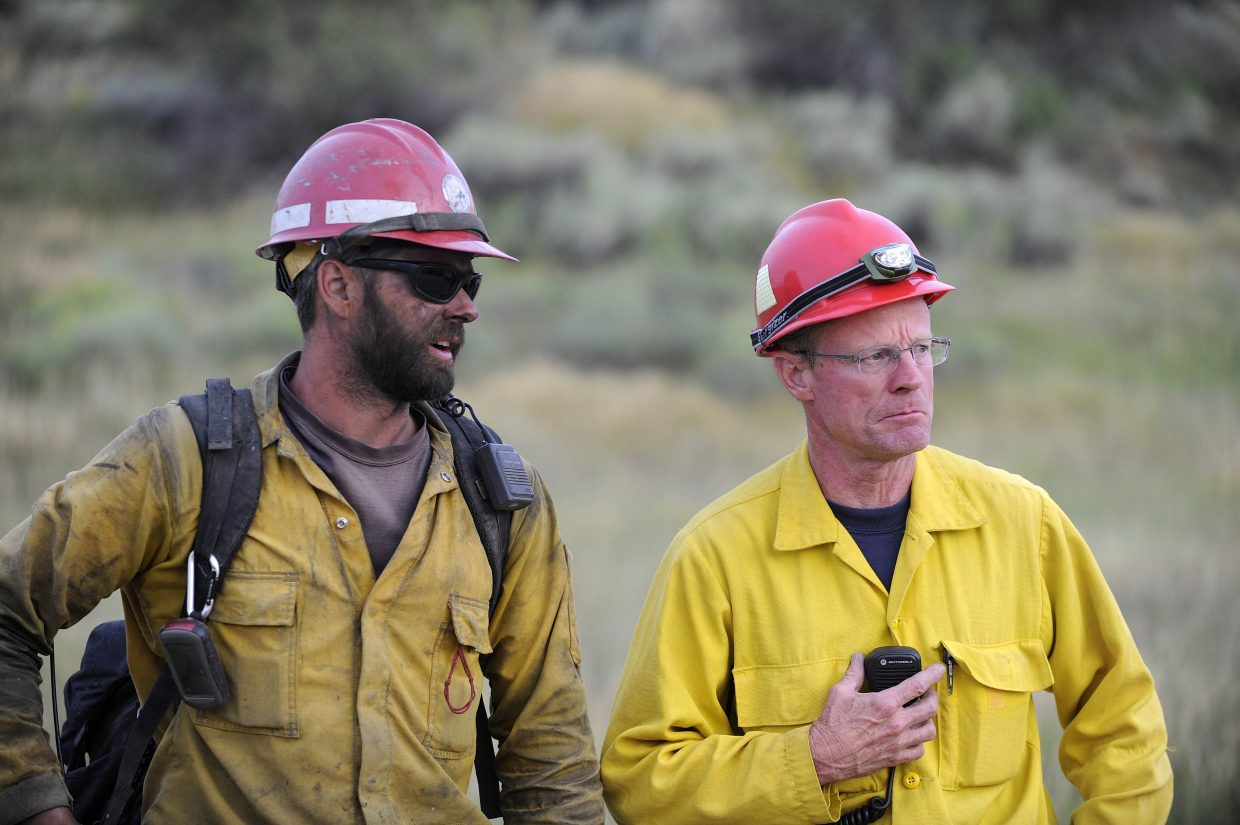 West Routt Fire Protection Capt. Dan Parrott, right, speaks with Bureau of Land Management firefighter Caleb Meyer.