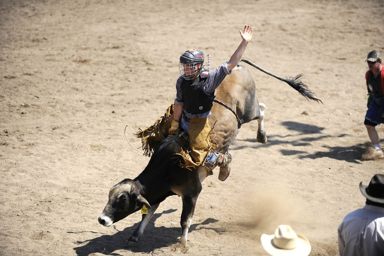 T-Lane Mazzola, 17, of Hayden, competes in the junior bull riding competition Saturday at the Routt County Fair.