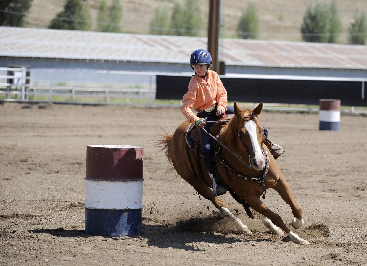 Cosette McLaughlin, 11, of Steamboat Springs, competes in the barrel racing competition Saturday at the Routt County Fair.