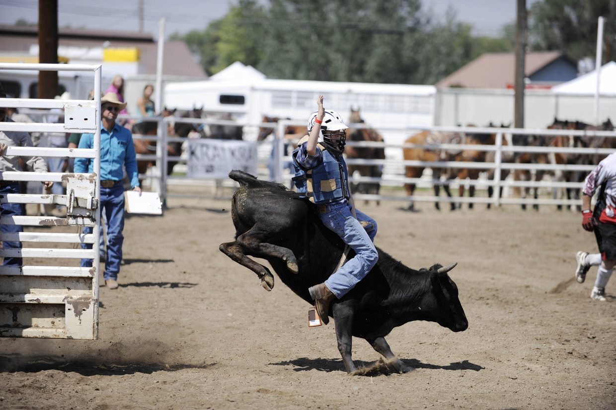 Hunter Planansky, of Hayden, competes in the junior bull riding competition Saturday at the Routt County Fair.