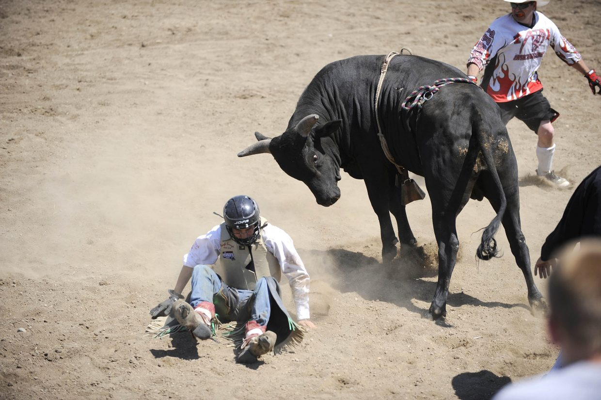 Colton Martindale, of Oak Creek, competes in the junior bull riding competition Saturday at the Routt County Fair.