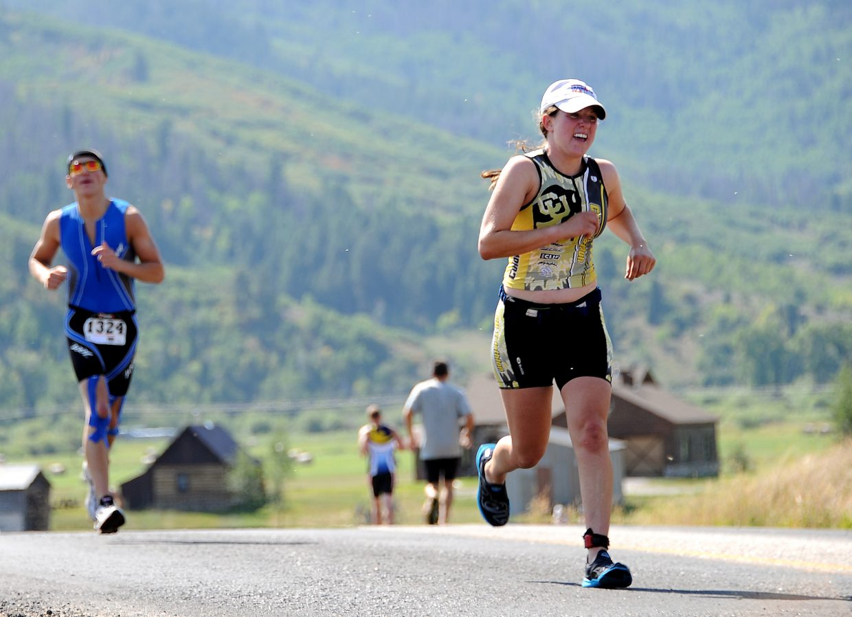 Boulder's Tess Amer runs down the road Sunday on the final stage of the Steamboat Triathlon in Steamboat Springs. Amer, one of nearly 400 racers to take to the course, was the race's second-fastest woman.