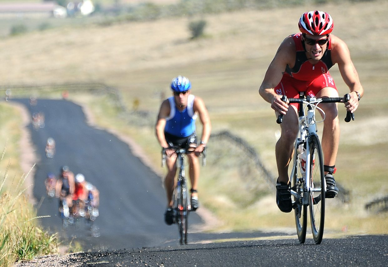 Denver's Craig Schmidt rides Sunday in the Steamboat Triathlon.