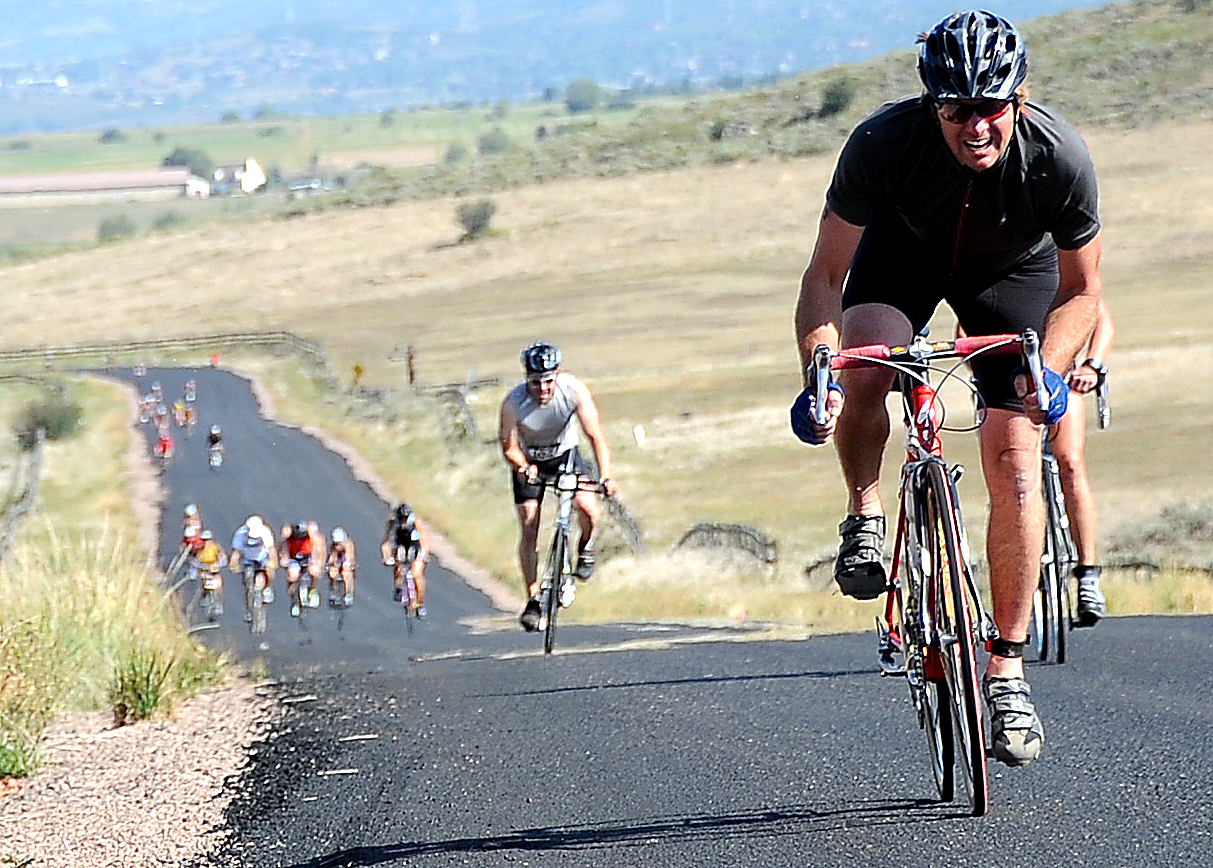 Riders charge up a hill Sunday in the Steamboat Triathlon.