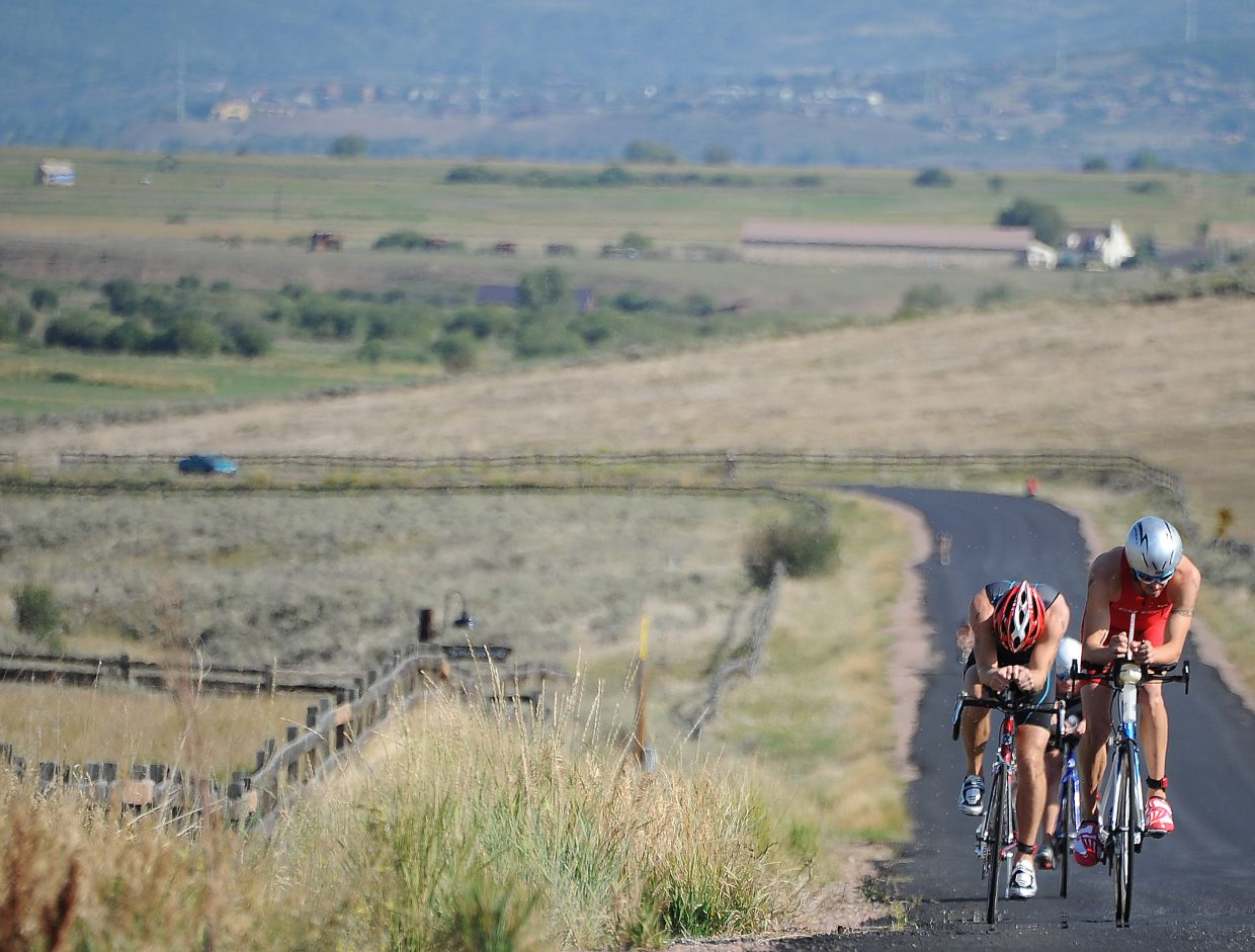 Riders climb near the end of the cycling leg of the Steamboat Triathlon on Sunday.