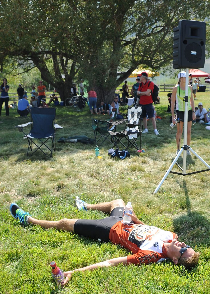 Centennial triathlete Chris Fons tries to recover after crossing the finish line of Sunday's Steamboat Triathlon.
