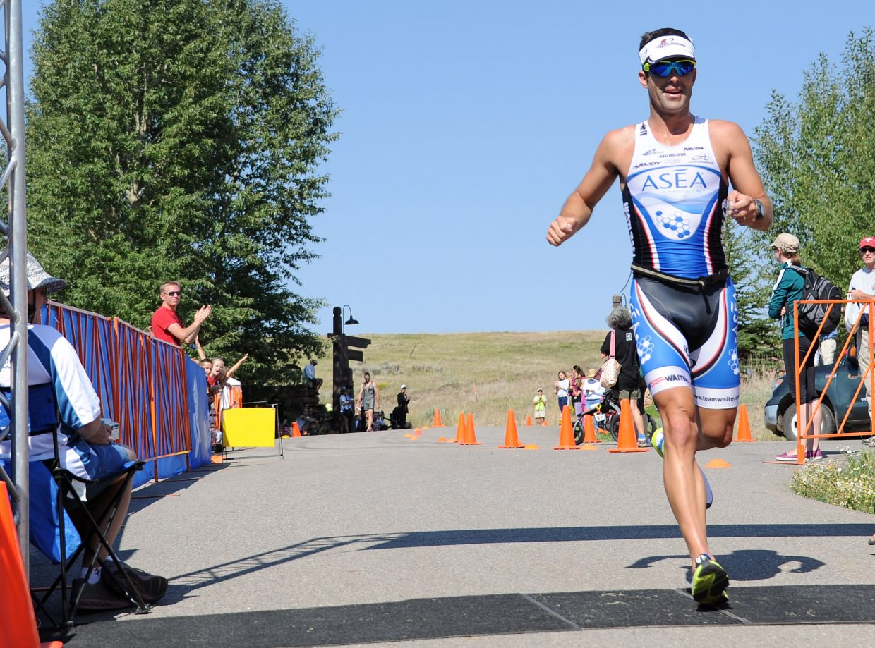 Cody Waite crosses the finish line in first place Sunday at the Steamboat Triathlon. Waite also won the Steamboat Lake Sprint Triathlon earlier this summer.