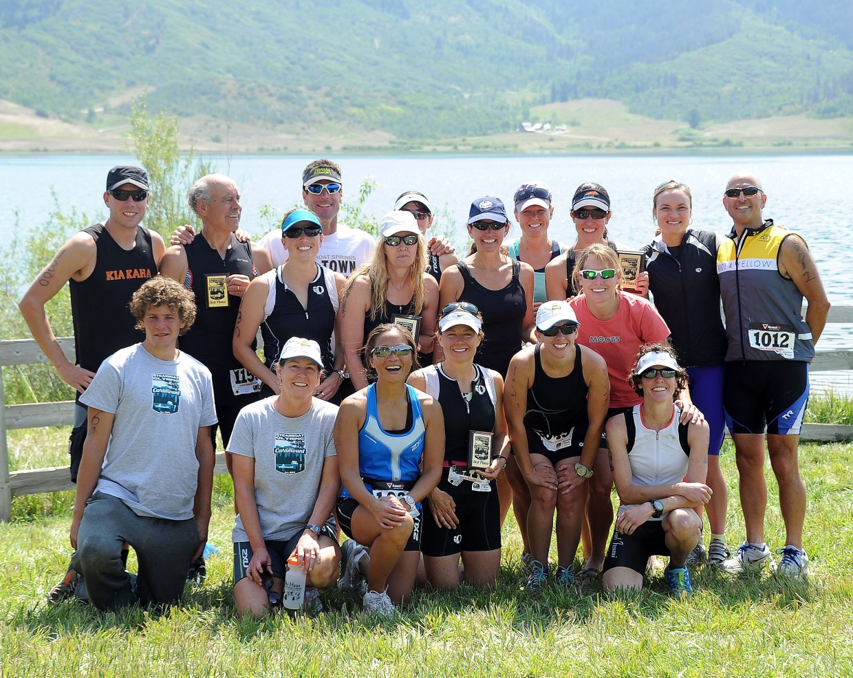 The Steamboat Springs Triathlon Club poses near the banks of Lake Catamount after Sunday's Steamboat Triathlon.