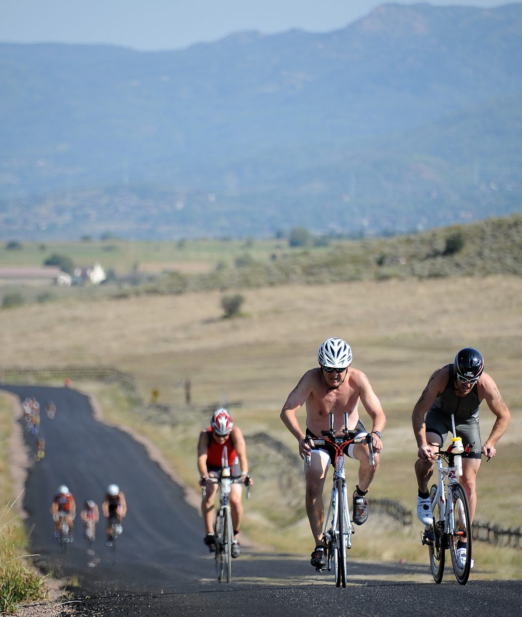 Athletes ride up the final hill on the bike course of Sunday's Steamboat Triathlon.