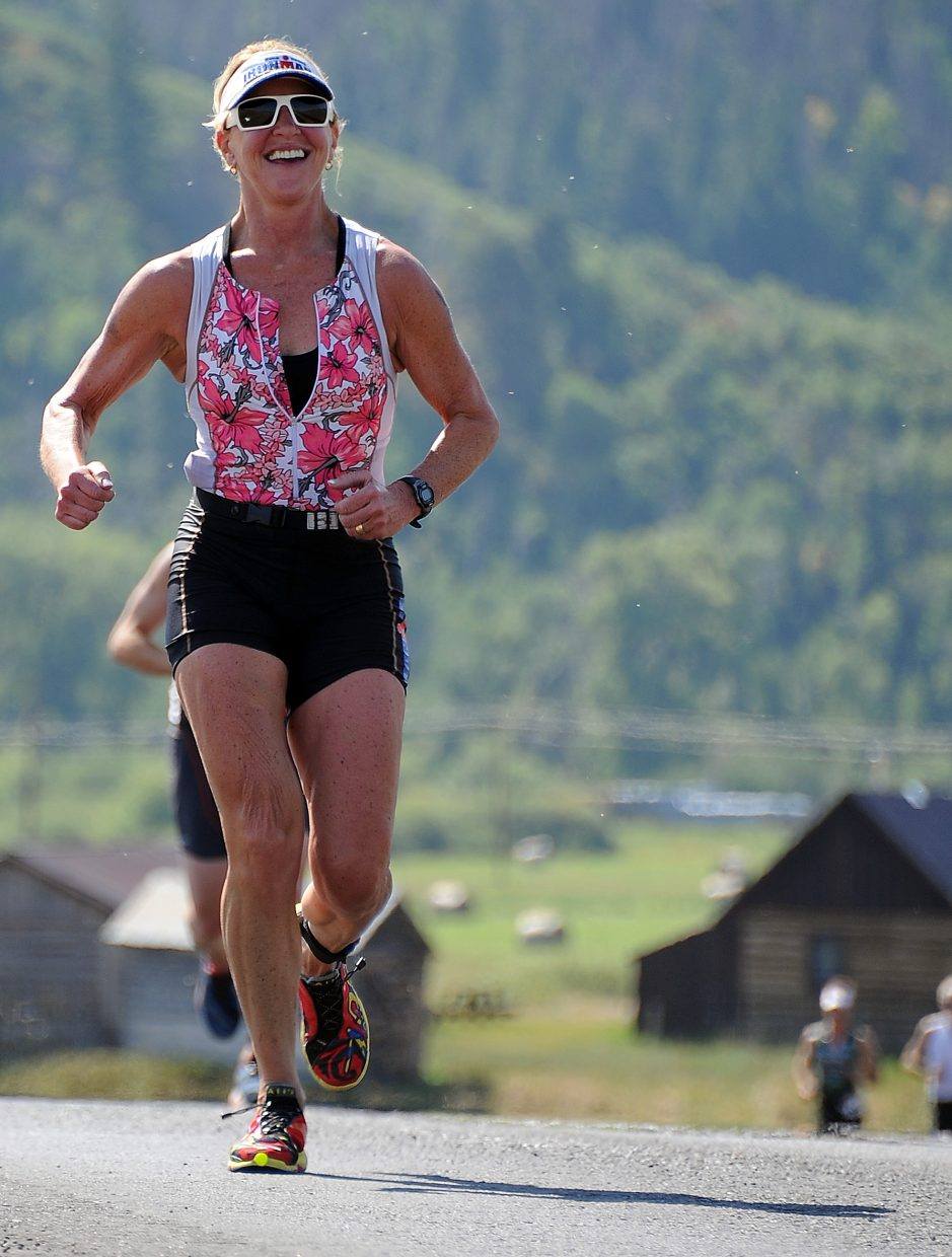 Joy Rasmussen-Otte runs Sunday in the Steamboat Triathlon.