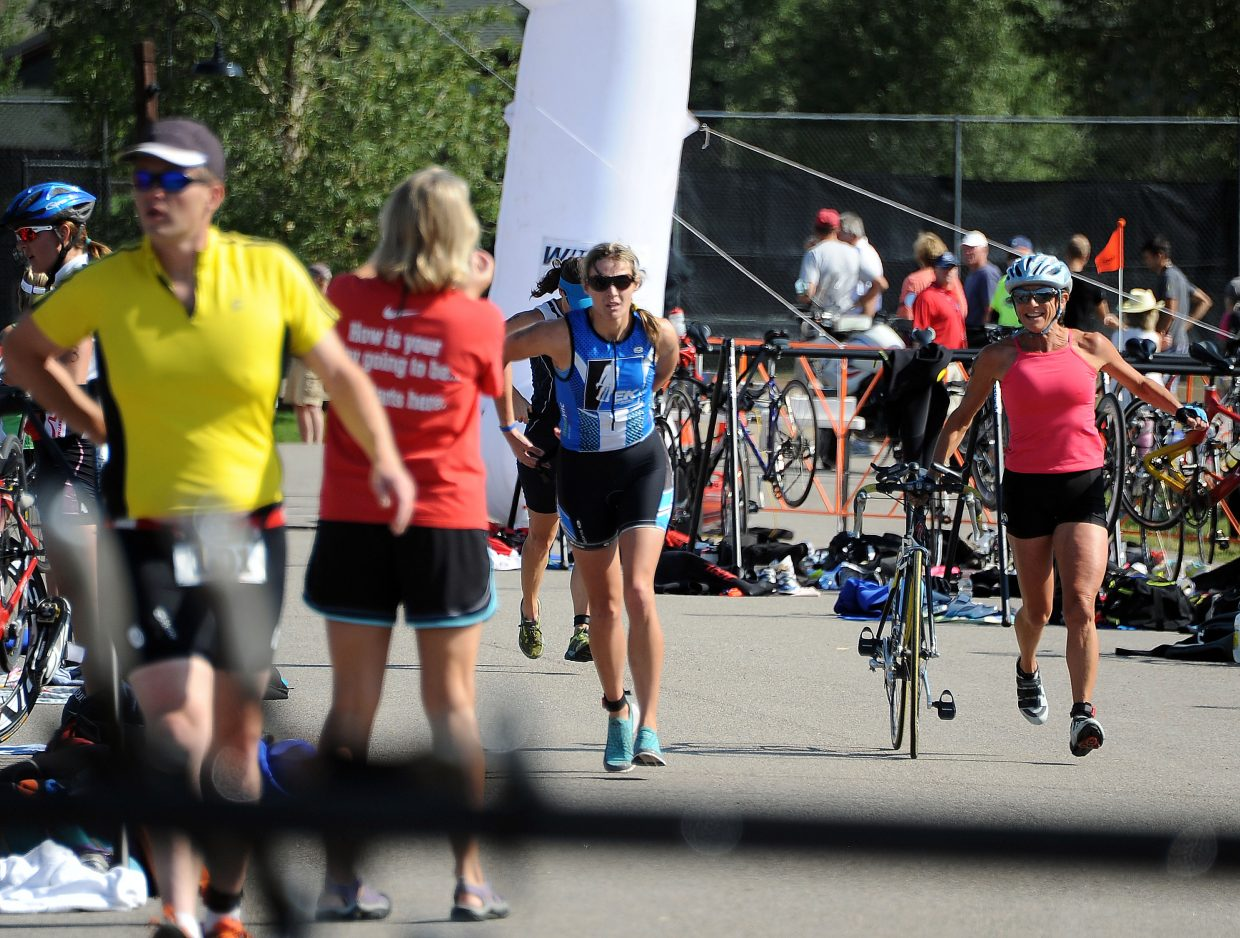 Racers charge into and out of the transition zone Sunday during the Steamboat Triathlon.