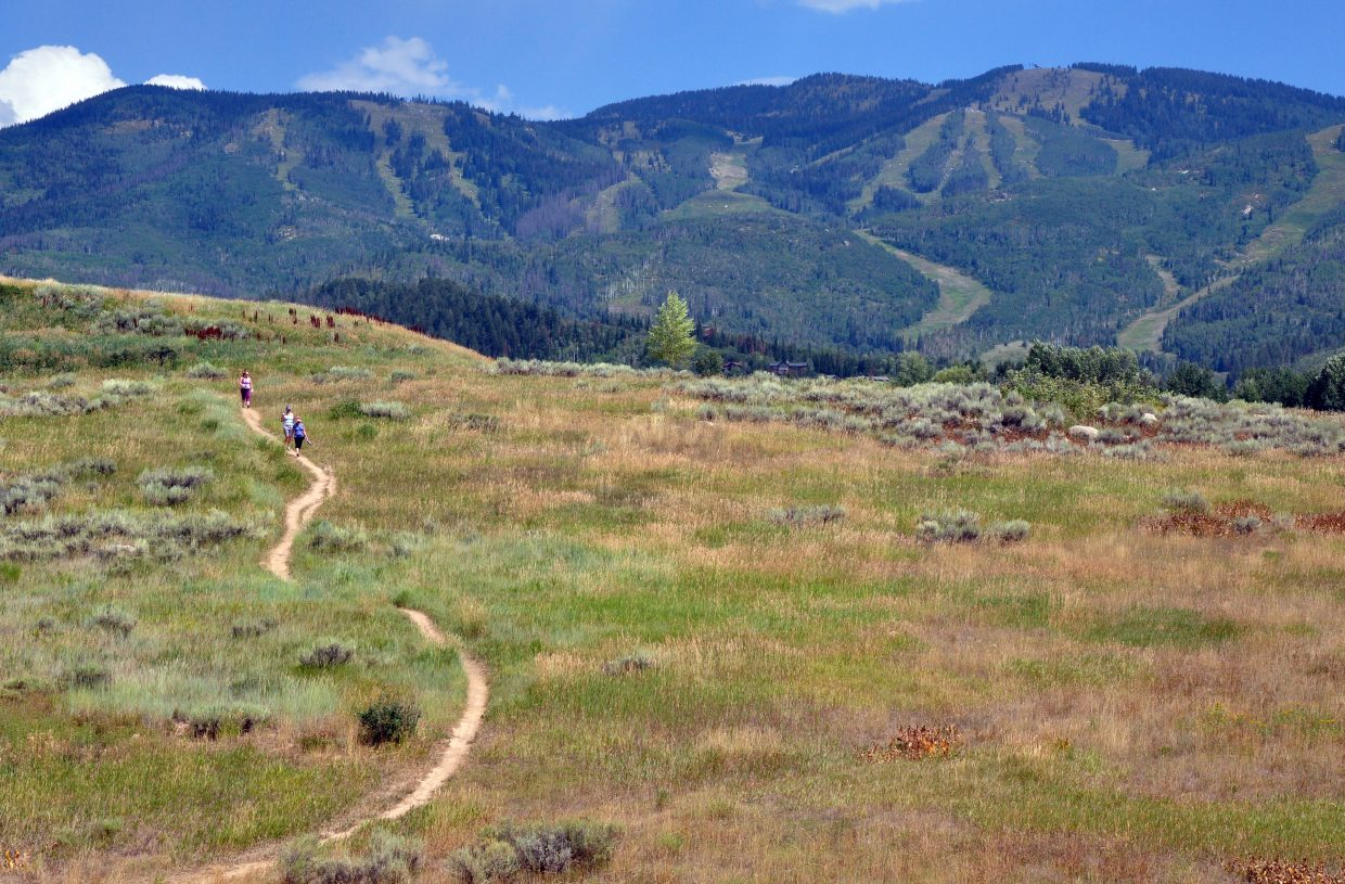 Hikers descend on a path at Rita Valentine Park near Longview Circle and Hilltop Parkway. The city of Steamboat Springs was eying a 3-acre parcel of the park directly across the street from Mill Run Court as the potential site of a new police station.