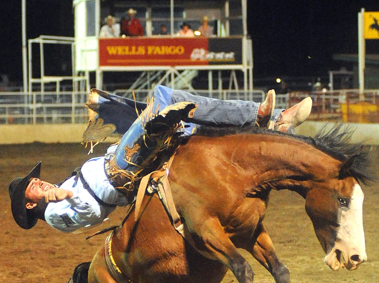 Thomas Baker hangs on with all he's got while riding bareback bucking horse Rikki Lake on Saturday at the Steamboat Springs Pro Rodeo series in Steamboat Springs. The rodeo's summer in Steamboat came to an end, wrapping up a 21-performance season.
