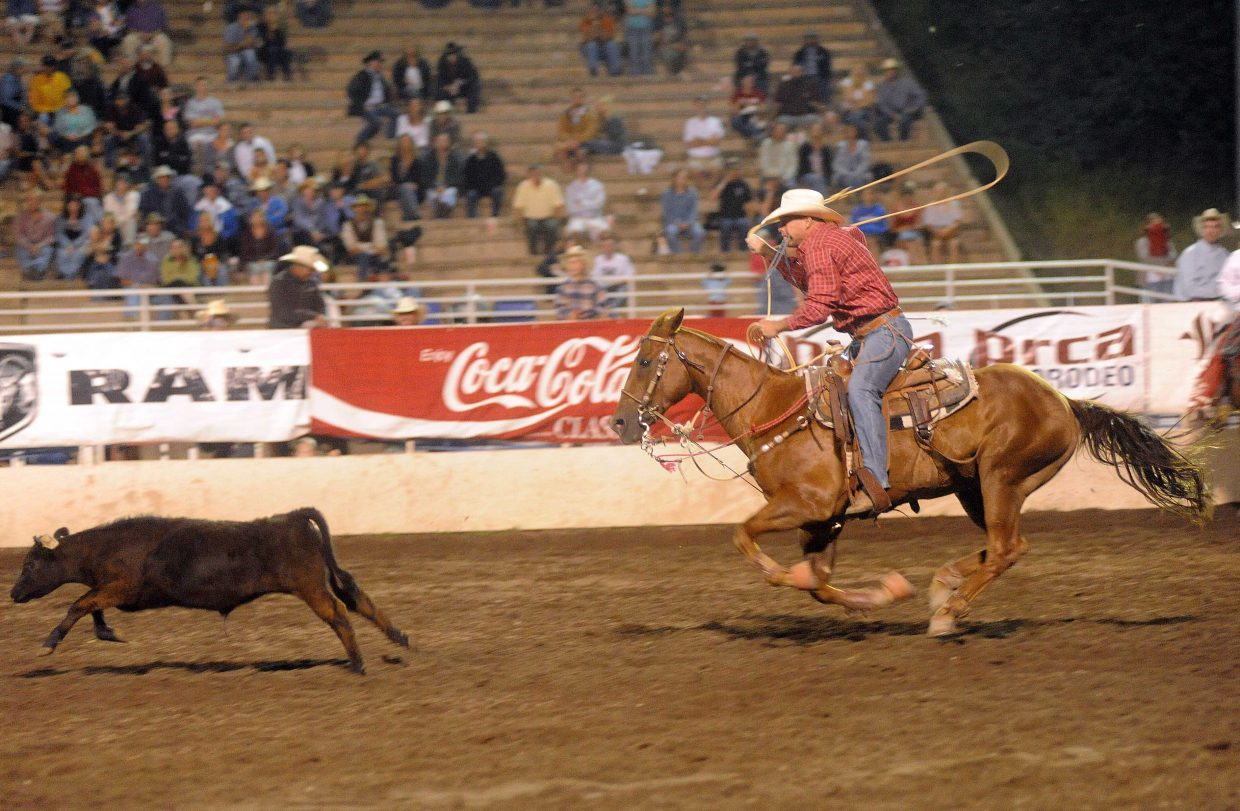Cory Zion gives chase to his calf during the tie-down roping Saturday at the Steamboat Springs Pro Rodeo Series.