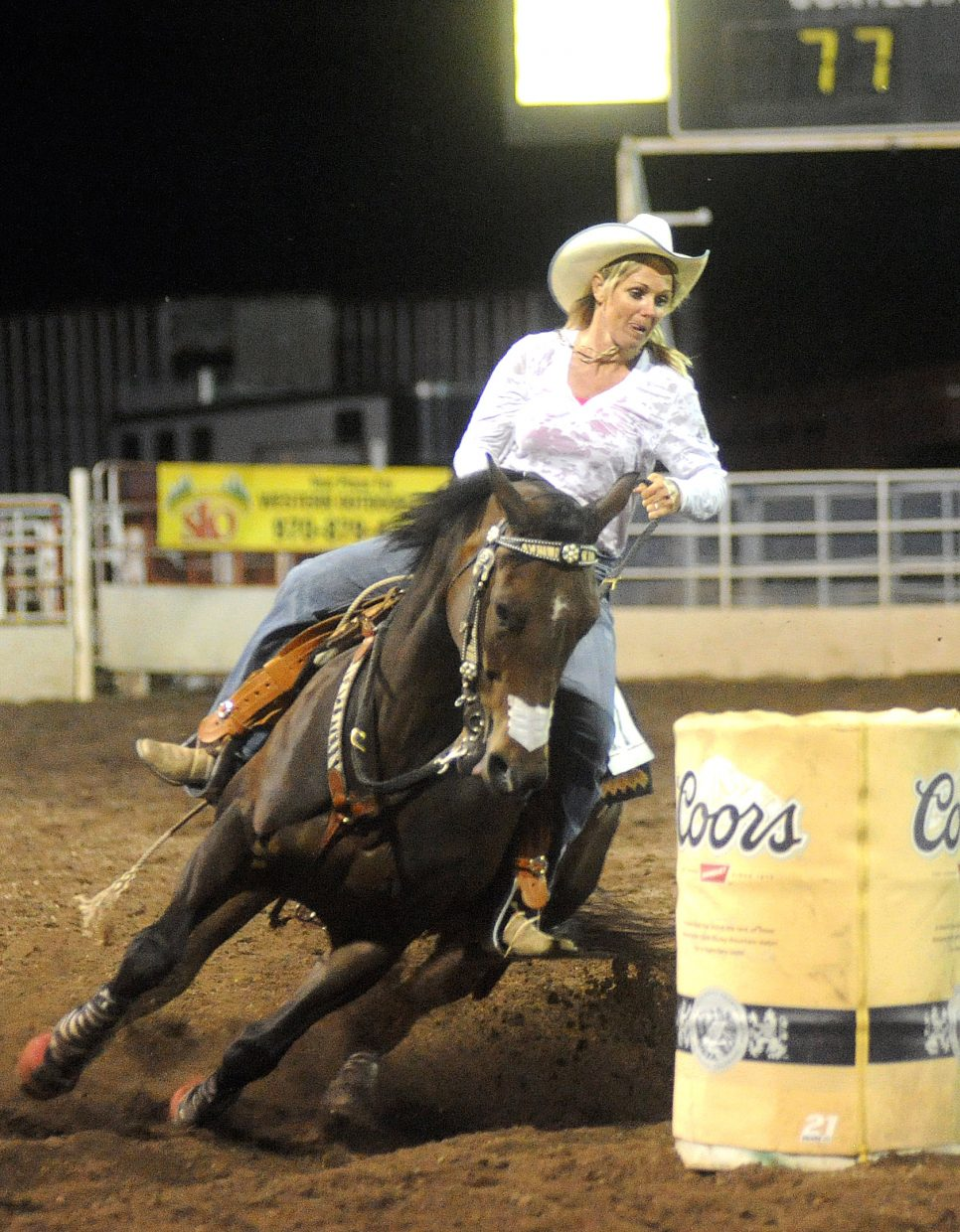 Walden's Bernice Richard cuts her horse around a barrel Saturday at the rodeo in Steamboat Springs.