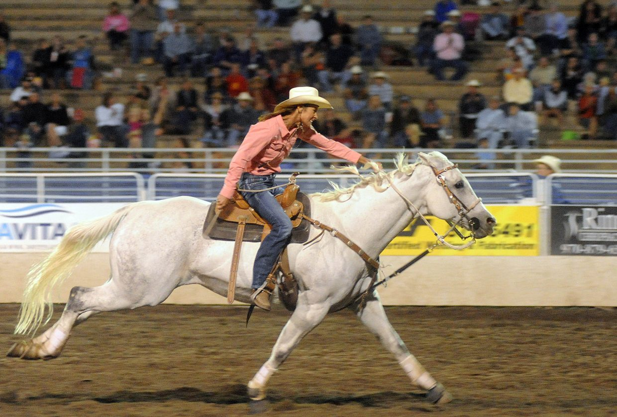 Julie Haskins flies through Brent Romick Rodeo Arena in Steamboat Springs on Saturday en route to her third consecutive and fifth overall barrel racing season championship.