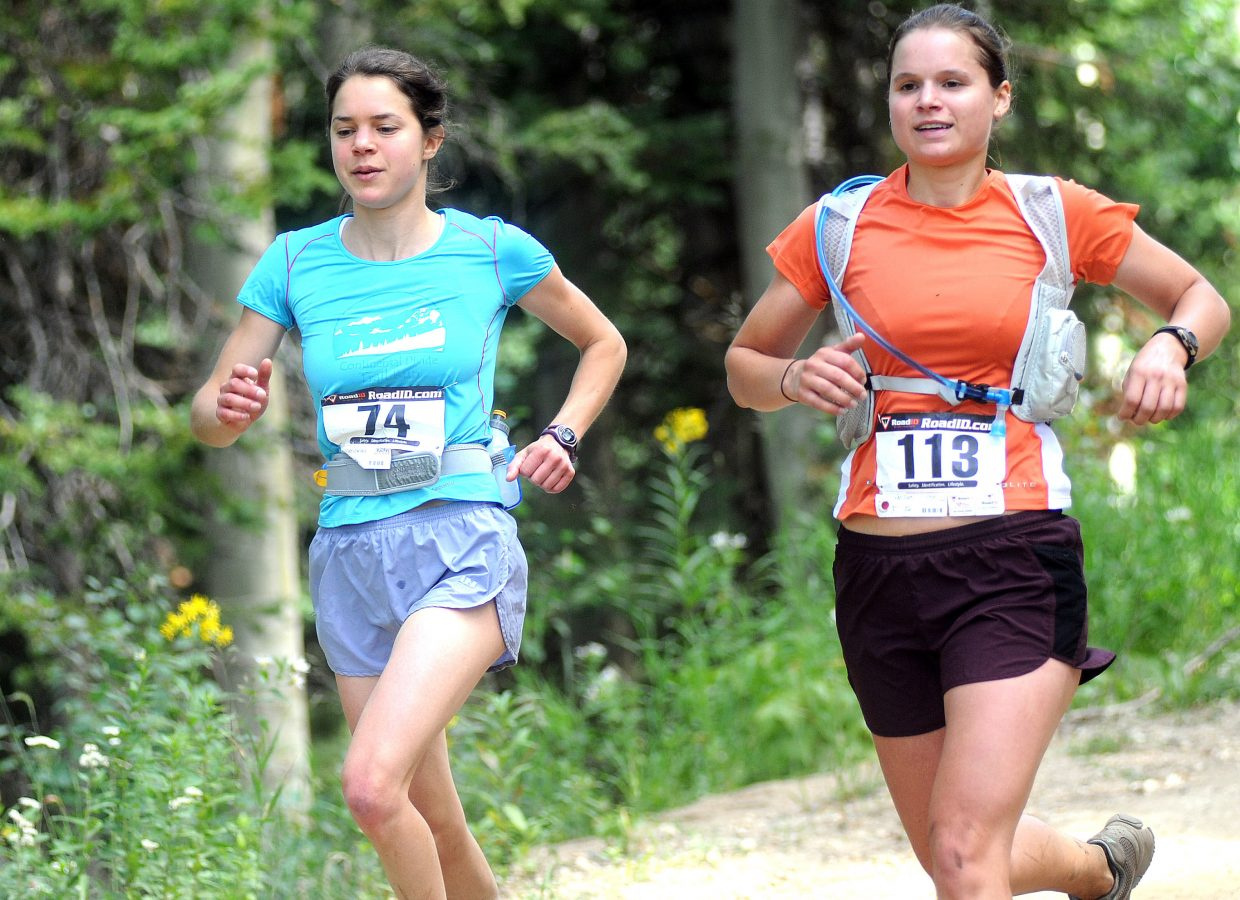 Robin Maslowski, left, and Brie Van Dam race Sunday in the Continental Divide Trail Run. The Steamboat Springs Running Series event sent riders on a 16-mile course through the mountains above Steamboat.
