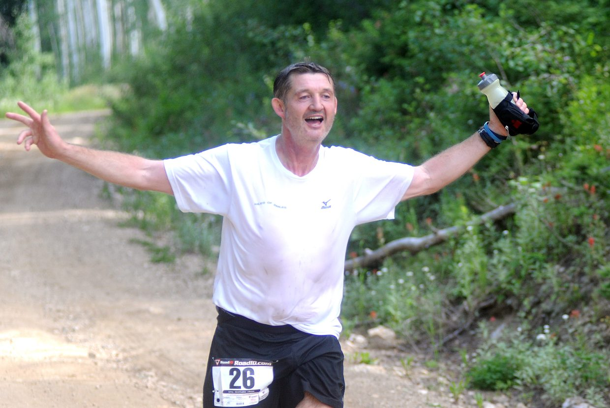 Sean Doran celebrates near the finish line Sunday during the Continental Divide Trail Run in Steamboat Springs.