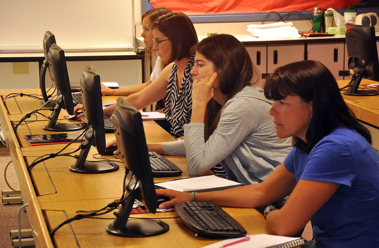 New teachers in the Steamboat Springs School District on Monday fill out self-evaluations during a workshop at Steamboat Springs High School. The district will roll out a new teacher evaluation system this school year.