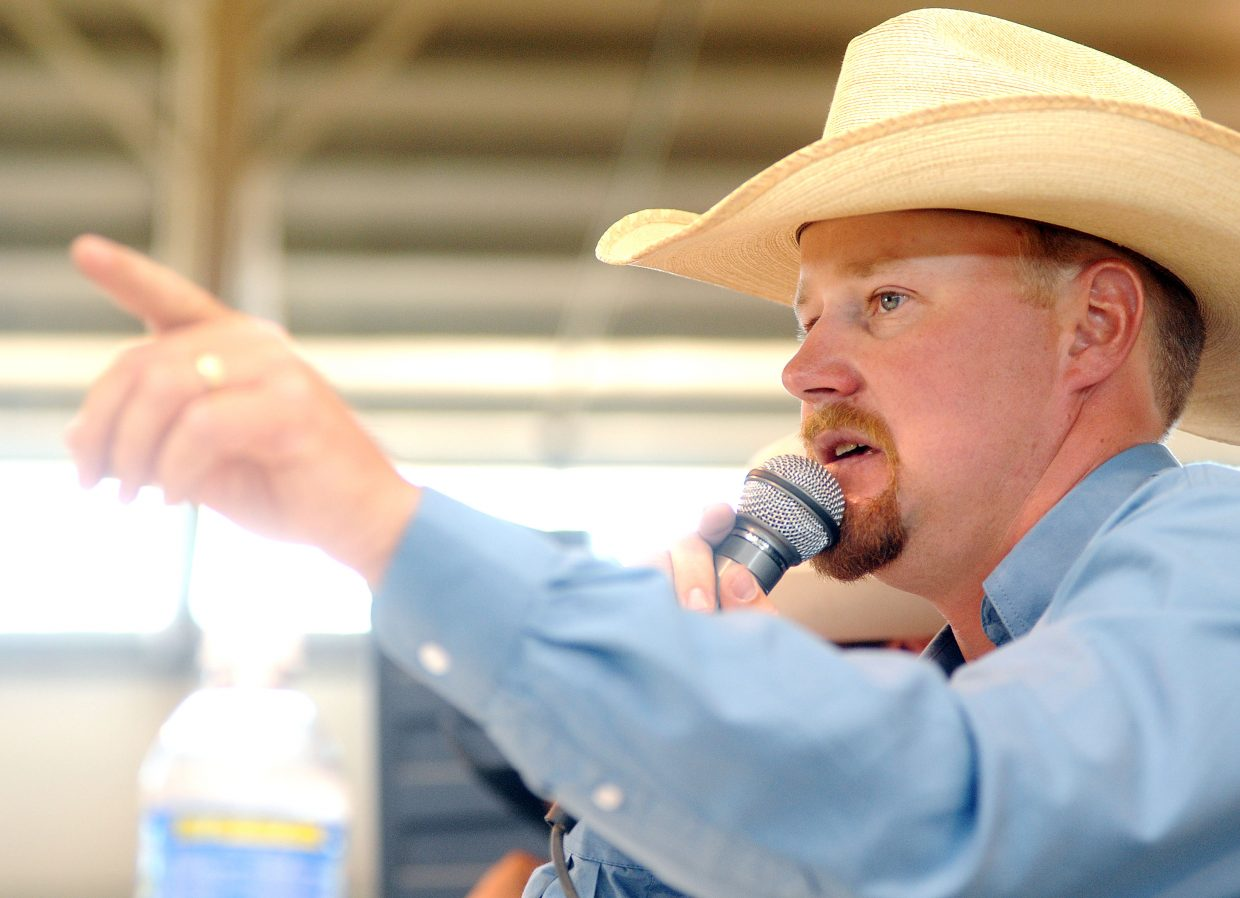 Auctioneer Chad Green calls the action Saturday at the Routt County Fair in Hayden.