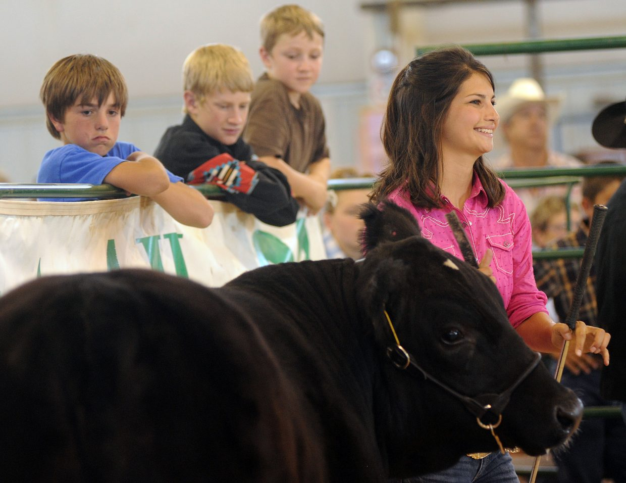 Ceanna Rossi leads her steer Saturday during the Routt County Fair in Hayden.