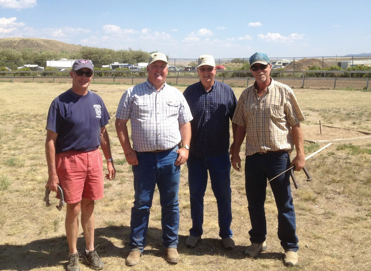 Routt County Fair horsehoe tournament champions Walt Ducey and Alan Ducey, center, are surrounded by runners-up Fritz Aurin, left, and Tom Armstrong, right, after the two teams played a tight final match Saturday in Hayden.