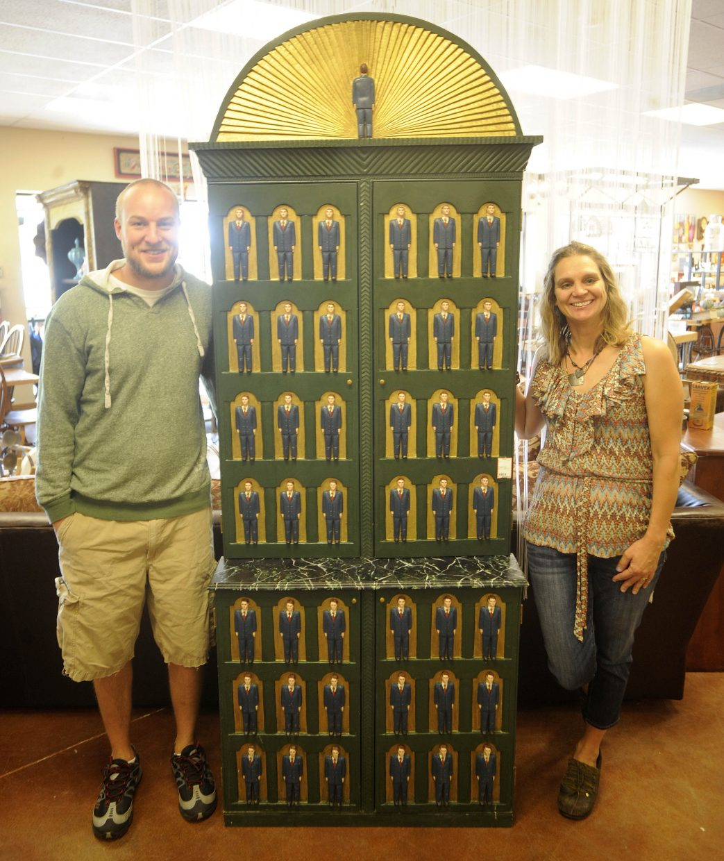 Steamboat Moxie Home Consignments and Design owner Michelle Caragol and employee Bryan Antalek spent weeks researching this cabinet before discovering it was worth $20,000.