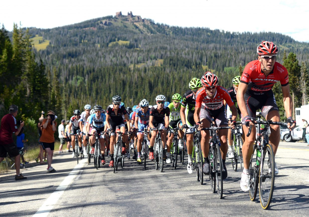 The peloton works its way up underneath Rabbit Ears Peak on Wednesday near the end of Stage 3 of the USA Pro Challenge. Hundreds greeted the riders on the pass and thousands more waited in Steamboat Springs. As they biked up, the peloton were trying to cut into the lead built by Jens Voigt and a pack of four other breakaway riders.