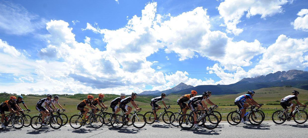 Riders make their way west on U.S. Highway 40 on Wednesday during Stage 3 of the USA Pro Challenge.
