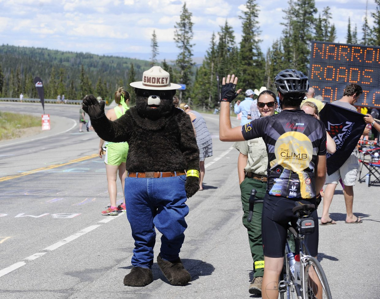 Smokey Bear visits fans at the east summit of Rabbit Ears Pass on Wednesday during the USA Pro Challenge.