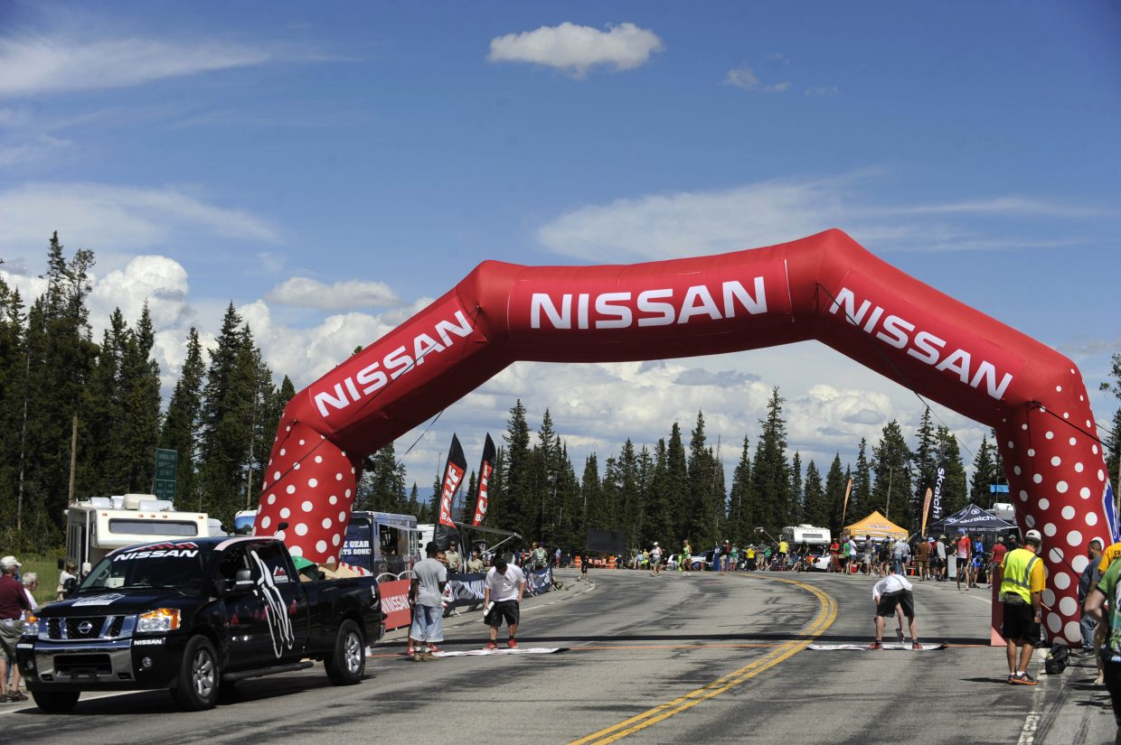 Workers prepare the King of the Mountain finish line at the east summit of Rabbit Ears Pass on Wednesday during the USA Pro Challenge.