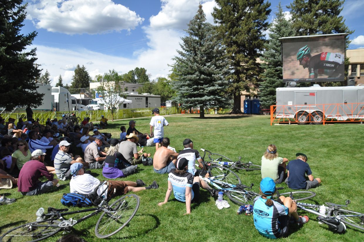 Crowds on the Routt County Courthouse lawn watch the racers get closer to Rabbit Ears Pass on Wednesday during the USA Pro Challenge.