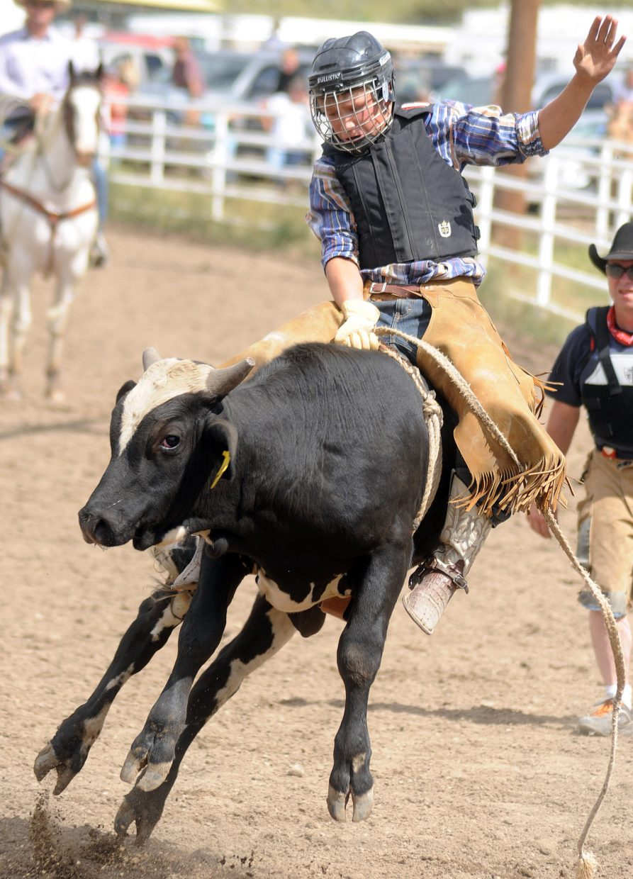Journey Freeman rides his bull during bull riding Sunday at the Routt County Fair in Hayden.