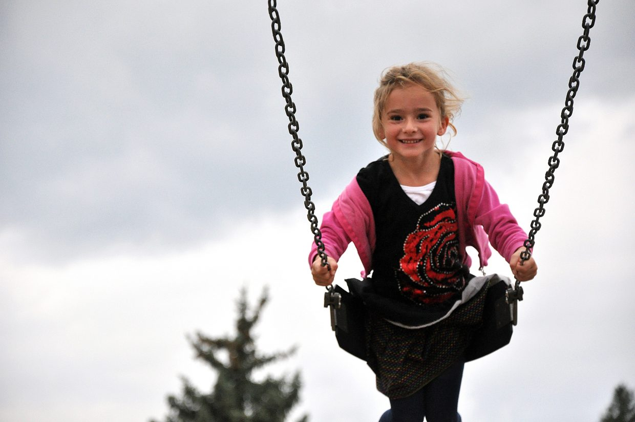 Josie Russell swings Wednesday during the first day of school at South Routt Elementary School in Yampa.